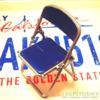 キャンドゥのミニチュアパイプ椅子(スマホスタンド)。