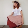 ピンクのプリーツスカート