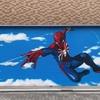 保育園のシャッターへエアーブラシでペイントアート