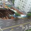 倒壊+地下部分 釜山で建設中の...