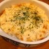 チーズドリアグラタン、タラモ、竹輪とかぼちゃのかき揚げ、鯖の味醂干し、玉子焼き、サラダチキン、塩豆、マンゴー