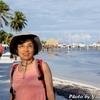 背景は中米ベリーズ屈指の海洋リゾート