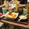 豊洲の「米花」でマグロ赤身、牛肉とネギの煮物、ニンニク芽酢味噌。