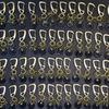 卒業記念品としてオリジナル刻印入りの革チャームがついた真鍮キーホルダーの御注文。