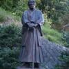 山田うどんと蓮沼門三像の写真