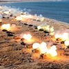北が大規模な砲撃訓練、米原潜は空母と合流へ