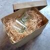 木屑に守られたショットグラス