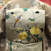 ベージュ地黒竹蔦柄錦紗小紋×鶯色菊と小鳥刺繍開き名古屋帯