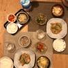 ごはん、鶏そぼろじゃが、トマトときゅうりの中華サラダ、キャベツと玉子の味噌汁、塩辛