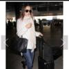 スタイリッシュなスタイルのセレブにはいつものスーツケースがある