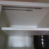 余白の多いキッチンの一番上の収納スペース