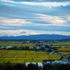 東川町の田園風景と森とお城(展望閣)と夕景