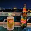 ホテルの9階、遠くにシュエダゴン・パゴダを見ながらミヤンマービール。