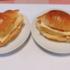 玉子焼きを半分に切ってロールパンに挟んでも良いですよ。「ちびねこ亭の思い出ごはん」 #再現料理 ( @z5FsLKLogCASDuT さん)