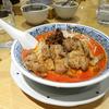 行列必至。カレー風味の排骨が乗っている希須林の排骨担々麺@東京都港区赤坂