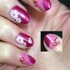 セルフネイル「ベースカラーが二色使いの桜とネイルスタッズ」の施し法