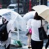 濡れた傘を閉じる時