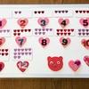 数字を遊びながら覚える『数字盤』を3歳娘用に手作り♪ねんどで作った「数字マグネット」に合わせ、ハート満載なデザイン!