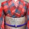 【着物コーディネート帖】明るい桃色のブロックチェックの米沢紬着物に春らしい花模様の名古屋帯を合わせて。