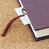 """もらった本に""""しおり""""として挟んであった千円札も、本をもらった人の物になるのか?"""