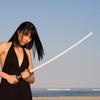Beautiful Asian woman with japanese sword-katana in black dress by the sea Ⅱ.(海辺で日本刀を構える黒いワンピース姿の美しいアジア人女性 其の二)