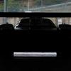 Pagani HuayraRと思われるティザー画像が公開 巨大なウイングを装着した実車のリアビュー