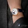 GPジラール・ぺルゴは非凡なのを持ってきて極致の精密で正確な貓目のシリーズの星明かりの夜空の月相の腕時計が美しいをのと表して彼女たちになります