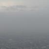 靄の向こうの山