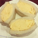 We are eating yellow sandwich