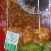 「宝食堂」の「名無し弁当(ゴーヤー・ミニ唐揚げ・タコミート等)」 320円