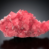 Rhodochrosite with Quartz on a matrix