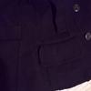 右側のポケット周りと裾だけがボロボロのピーコート。食い止め修復
