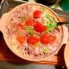 こぶ高菜とトマトのトロ卵黒米雑炊