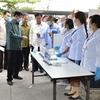 ラオス・トンルン首相:病院、空港、国境橋を訪問し、新型コロナウイルスへの対策状況を視察