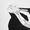 『覆う手』