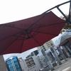 夏場に赤いパラソルはいかがですか。2~3人で組み立て可能!