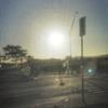 シャトルバスの車窓からみた夕日と工事中の鉄道。。。。