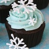 Chocolate cupcakes with vanilla cream cheese frosting and topped with