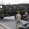 沖縄市知花で大型米軍車両が右折 ! 直進の普通乗用車と衝突、普通乗用車の女性は軽傷、四時間半の渋滞を引き起こす