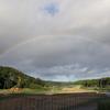 弧を描く美しい虹発見。