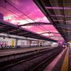 マジックアワーとJR西日本の駅の風景と夕陽に照らされるガントリークレーン。