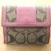 お財布を長財布から二つ折りへ小さくしました。