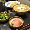 豊洲の「米花」で牡蠣・白子豆腐、ロールキャベツ、まぐろ刺身、ほうれん草としめじのおひたし。