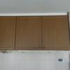 子供の作品の意外な収納法(吊戸棚に段ボールで)