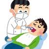 歯医者の痛かったら手をあげてーってさ