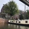 アムステルダムの運河に建つ水上ハウスに住むという選択とは