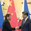 中国・フィリピン首脳、南シナ海「対話で解決」