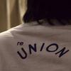 プレカリアートユニオンが(組合名の入っていない)Tシャツを作りました!会社で社長や店長の理不尽に言い返せる勇気を持てるようなTシャツ