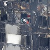 英高層火災、死者17人に…犠牲者数増える恐れ