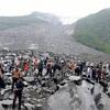 四川省で土石流、15人死亡・110人不明